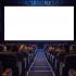 PraCegoVer: plateia vista de costas em uma sala de cinema